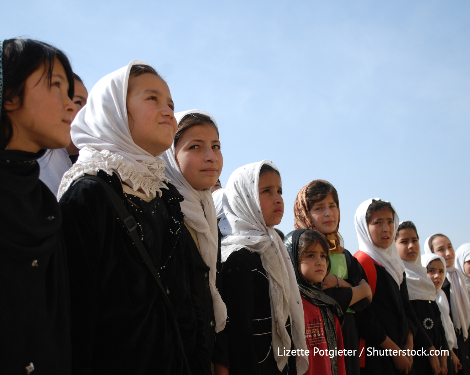 MAZAR - OCTOBER 31: Afghan school girls, from Mazar, Balkh, stand on attention October 31, 2009 during a ceremony in Mazar, northern Afghanistan. School receives foreign donor support.